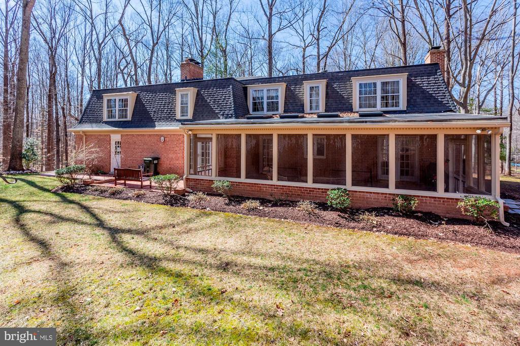The house has a large screened-in porch. - 11726 WINTERWAY LN, FAIRFAX STATION