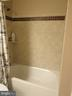 Hall bathroom with tub/shower combo - 10623 LEGACY LN, FAIRFAX