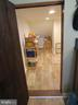 Under stairs storage with tile floor - 10623 LEGACY LN, FAIRFAX
