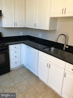 Newly installed black granite with gold spec tops - 555 MASSACHUSETTS AVE NW #202, WASHINGTON
