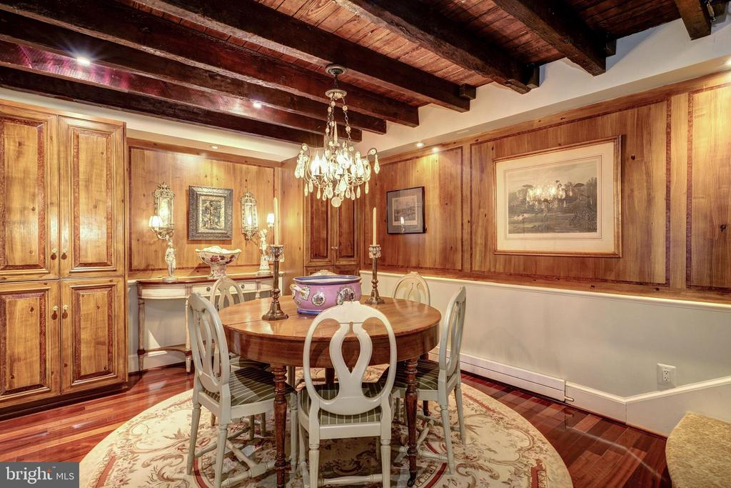 Dining room features exposed beams. - 1423 36TH ST NW, WASHINGTON