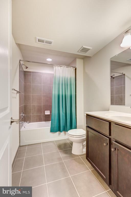 Full bathroom in the lower level - 1148 HOLDEN RD, FREDERICK