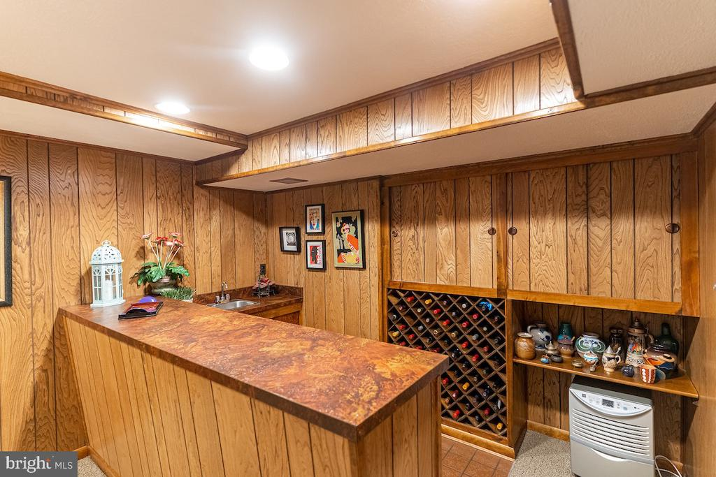 A Basement Bar with a 70 bottle wine storage! - 11905 VIEWCREST TER, SILVER SPRING