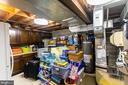 Basement storage rm with add. fridge and freezer. - 11905 VIEWCREST TER, SILVER SPRING