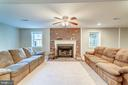 Basement rec room with wood burning fireplace - 7102 BYRNELEY LN, ANNANDALE