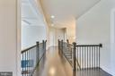 Upper level hallway with wrought iron railing - 41178 CHATHAM GREEN CIR, ALDIE