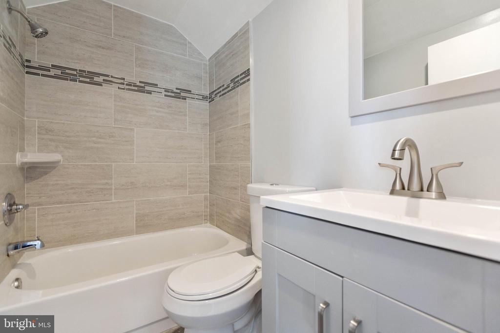 One of your full bathrooms w/ shower and bathtub. - 6420 13TH ST NW, WASHINGTON