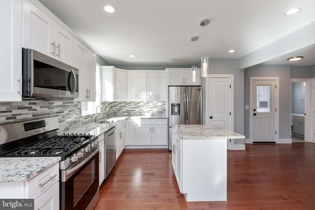 Your kitchen w/ ample cabinets, island & pantry. - 6420 13TH ST NW, WASHINGTON