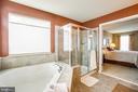 Ceramic tile enhances the seated shower - 75 COLEMANS MILL DR, FREDERICKSBURG
