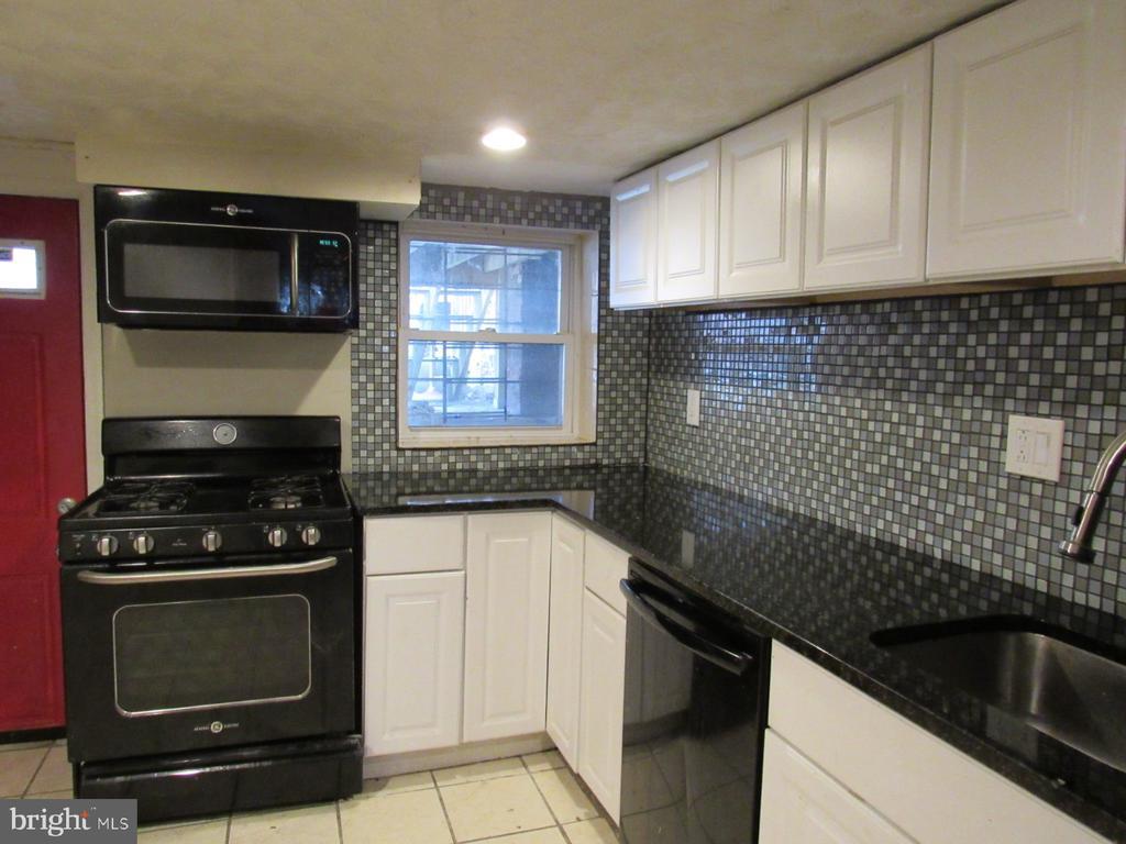 Lower level unit kitchen - 1803 2ND ST NW, WASHINGTON
