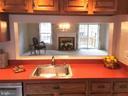 Open floor plan, from kitchen into living area - 2550-B S ARLINGTON MILL DR #B, ARLINGTON
