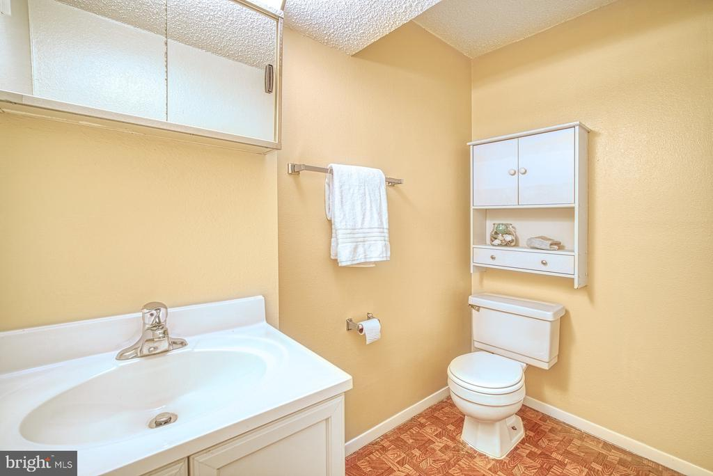 lower level half bath - 8105 WILLOWDALE CT, SPRINGFIELD