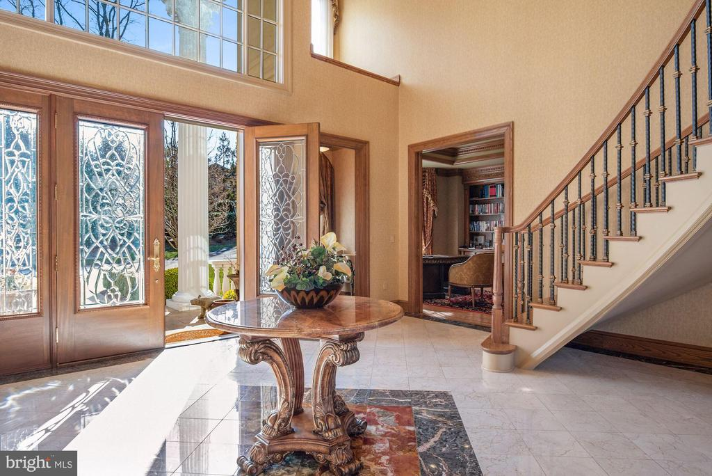 Foyer Flanked by Cased Entry to Library - 896 ALVERMAR RIDGE DR, MCLEAN