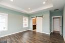 Master bath w tray ceiling and barn door - 6720 ACCIPITER DR, NEW MARKET