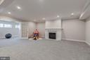Recreation rm w/ fireplace and adjoing exercise rm - 4909 FALSTONE AVE, CHEVY CHASE