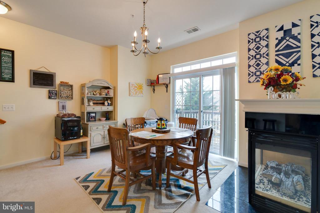 Dining Area also has sliding doors leading to deck - 13949 HOLLOW WIND WAY #201, WOODBRIDGE