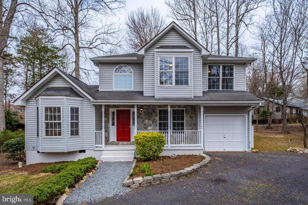 Front Exterior with Landscaping - 105 MUSKET LN, LOCUST GROVE