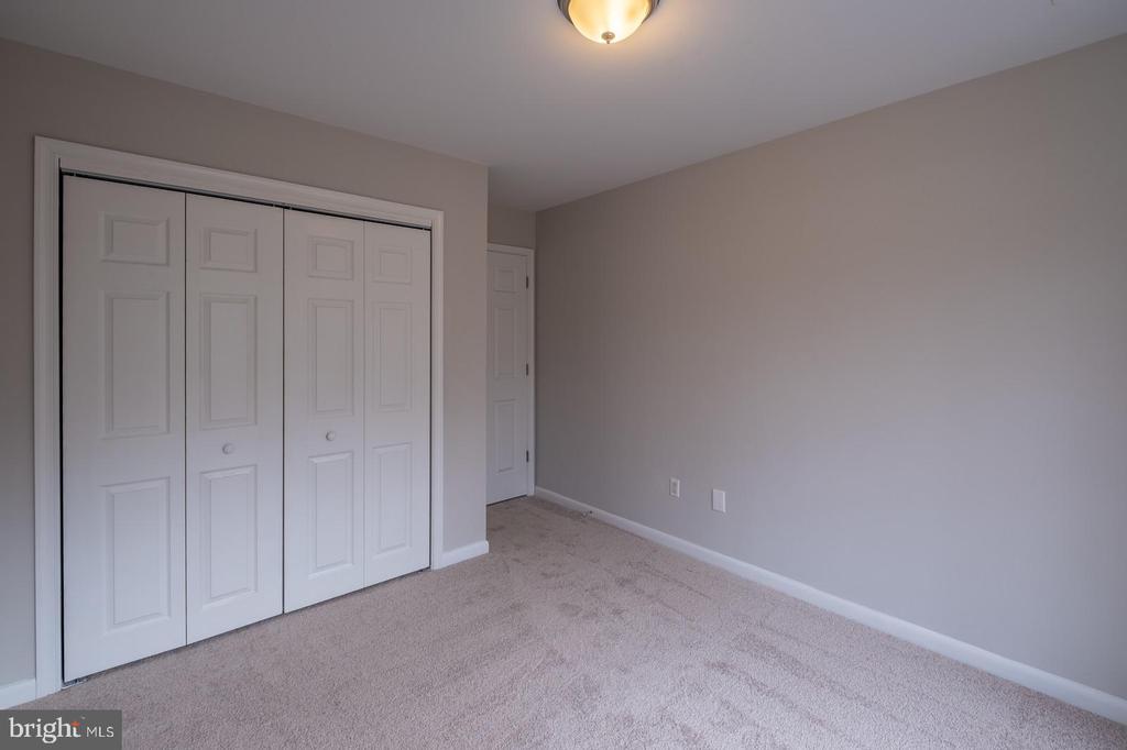 Bedroom 2 with French Door Closet - 105 MUSKET LN, LOCUST GROVE
