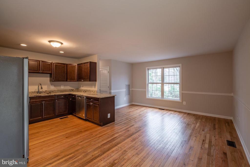 Kitchen/Dining Area with Hardwood Floors - 105 MUSKET LN, LOCUST GROVE