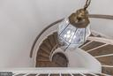 Dramatic curved staircase leads down to main level - 1401 N OAK ST #302, ARLINGTON