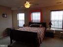 Master Bedroom w/ Ceiling Fan & Wood Blinds - 12509 HAWKS NEST LN, GERMANTOWN