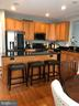 Large island and tall cabinets. - 241 WOODSTREAM BLVD, STAFFORD