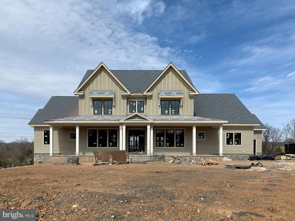 Novella's interpretation of the modern farmhouse. - 22984 MUNSUN PL, LEESBURG