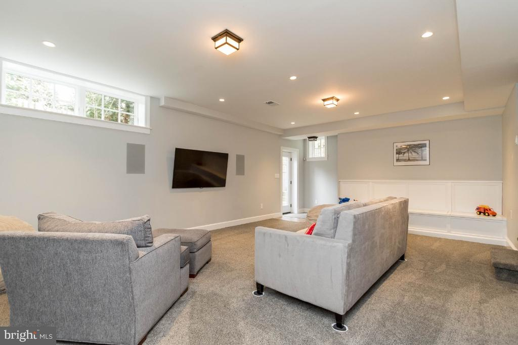 Lower level rec rm with tv that conveys - 6308 26TH ST N, ARLINGTON