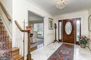 Marbled entryway - 7608 ARROWOOD RD, BETHESDA
