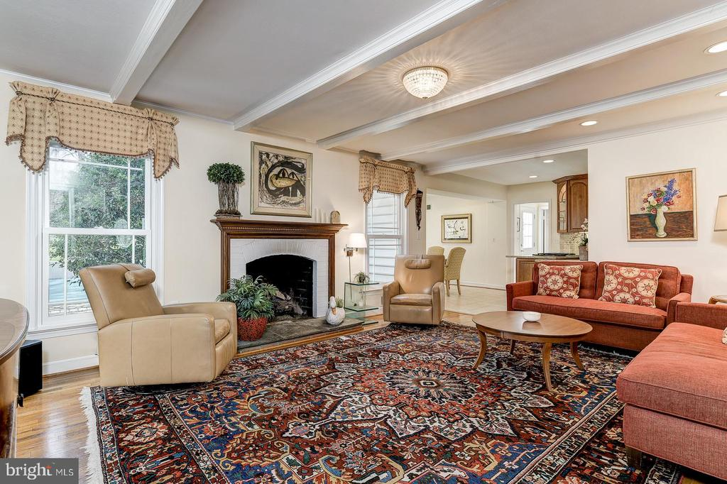 Family room with beamed ceiling and gas fireplace - 7608 ARROWOOD RD, BETHESDA