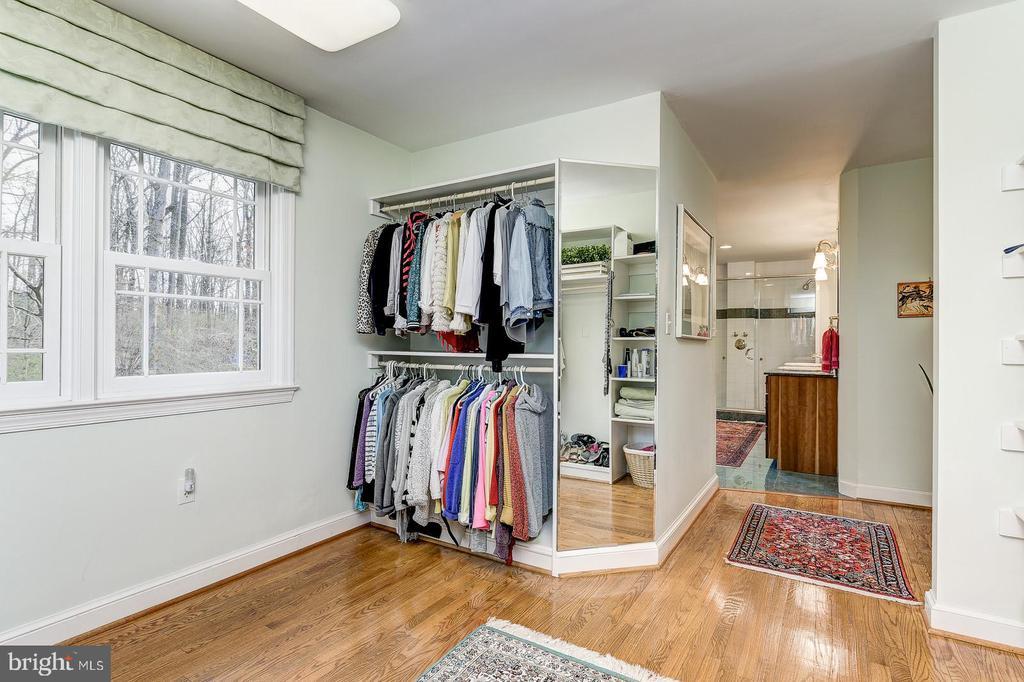 Master bedroom closet open to master bathroom - 7608 ARROWOOD RD, BETHESDA