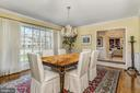 Dining room with floor to ceiling bay window - 7608 ARROWOOD RD, BETHESDA