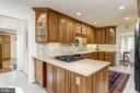 Granite topped kitchen with gas burners - 7608 ARROWOOD RD, BETHESDA