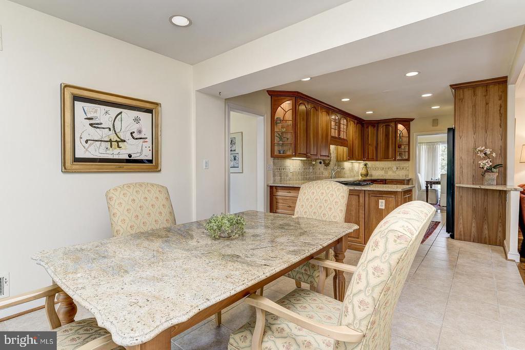 Breakfast room open to kitchen - 7608 ARROWOOD RD, BETHESDA