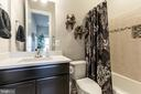 Main lvl master bathroom. - 14515 FALCONAIRE PL, LEESBURG
