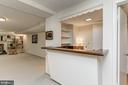 Wet bar in lower level family room - 7608 ARROWOOD RD, BETHESDA