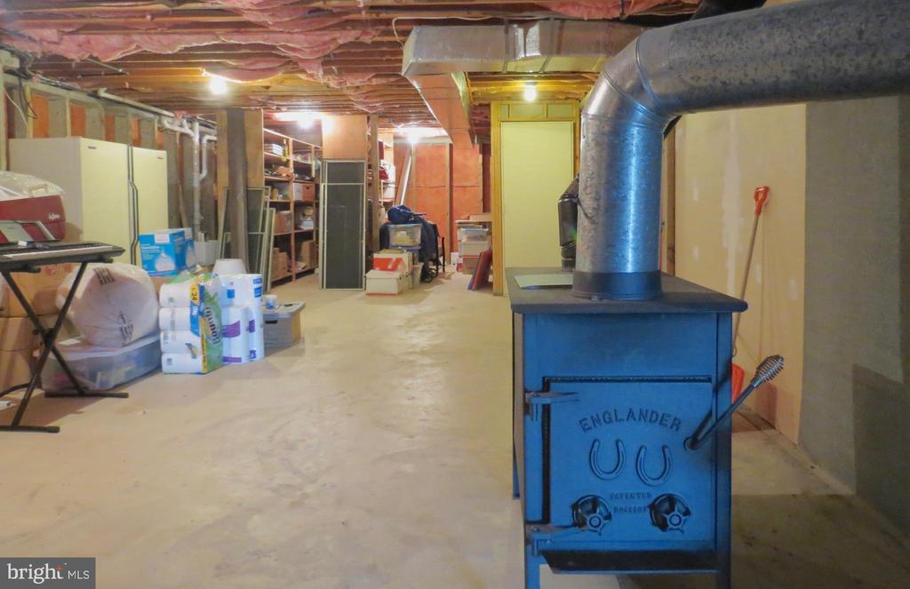 Basement storage shelving.  Great wood stove! - 335 FODDERSTACK RD, WASHINGTON