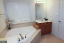 Notice separate sinks and tub - 147 HERNDON MILL CIR, HERNDON