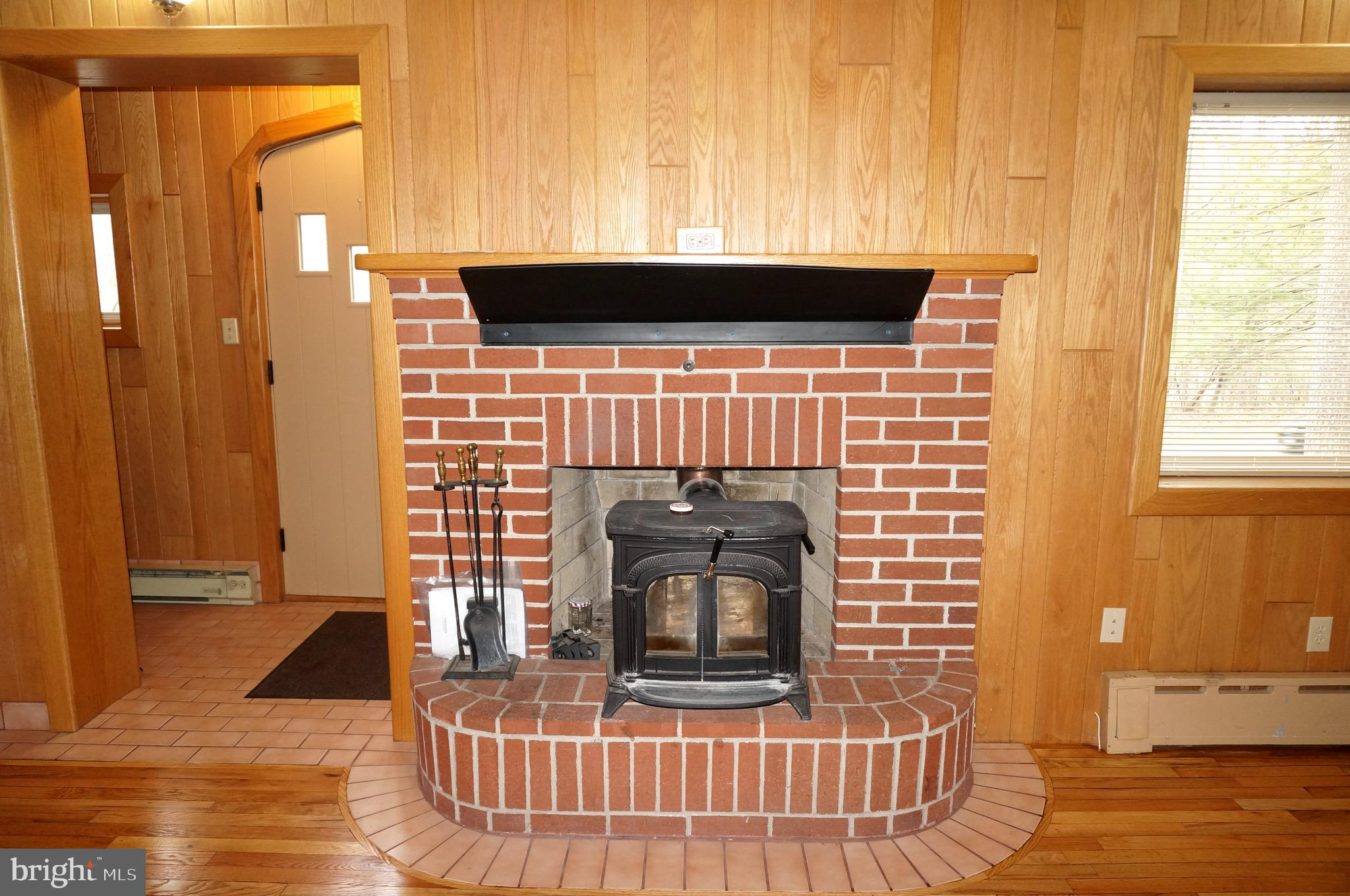 Brick Fireplace with Efficient Wood Stove Insert