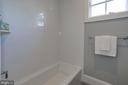 tub and toilet in separate area of shared bath - 5010 25TH RD N, ARLINGTON