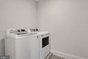 washer and dryer are set on raised drain - 5010 25TH RD N, ARLINGTON