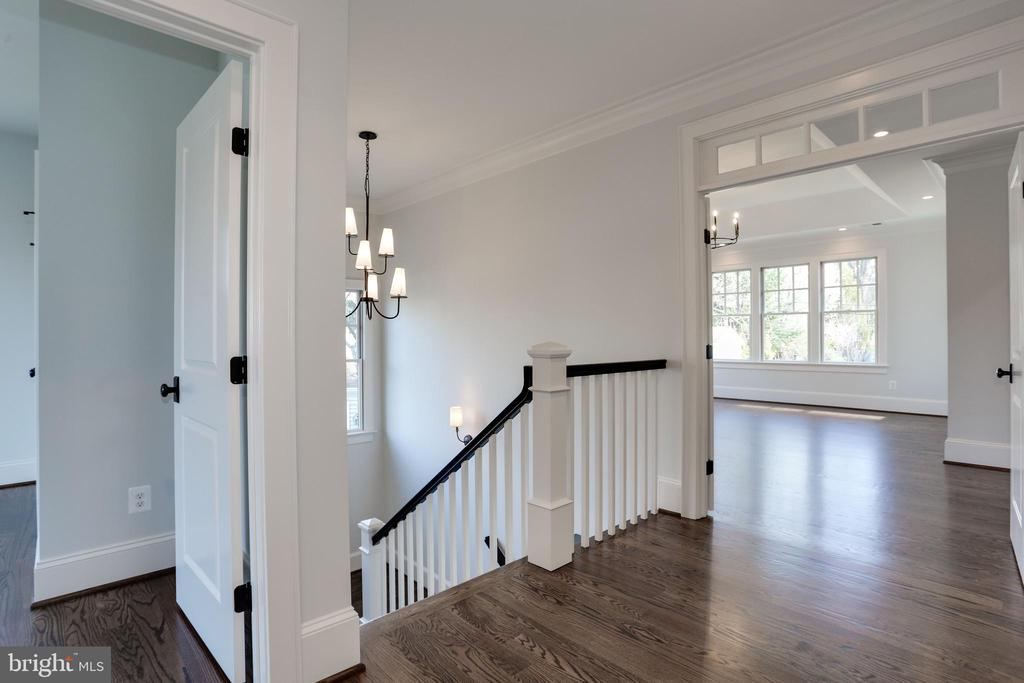 upper hall with sculptural light above stairwell - 5010 25TH RD N, ARLINGTON