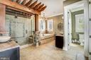 Detailed tile work in spa like Master Bathroom - 13509 PATERNAL GIFT DR, HIGHLAND