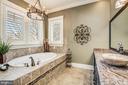 Elegant jetted soaking tub in Master Bathroom - 13509 PATERNAL GIFT DR, HIGHLAND
