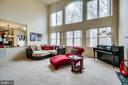 Two story family room with picture windows - 13451 GRAY VALLEY CT, CENTREVILLE
