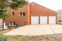 THREE CAR GARAGE WITH EXPANDED CONCRETE PARKING - 7365 BEECHWOOD DR, SPRINGFIELD