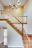 VIEW OF UPPER LEVEL STAIRCASE FROM FRONT DOOR - 7365 BEECHWOOD DR, SPRINGFIELD