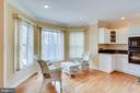 KITCHEN TABLE AREA WITH EXTENDED SIZE WINDOWS - 7365 BEECHWOOD DR, SPRINGFIELD