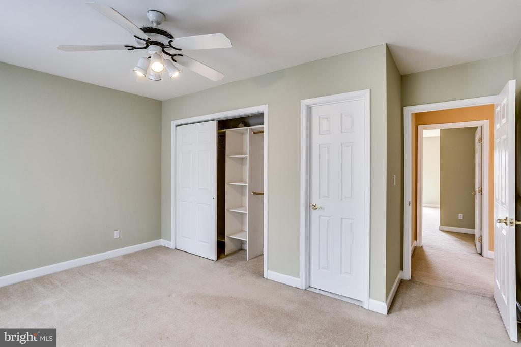 UPPER LEVEL BEDROOM -CLOSETS AND BATHROOM DOORS - 7365 BEECHWOOD DR, SPRINGFIELD