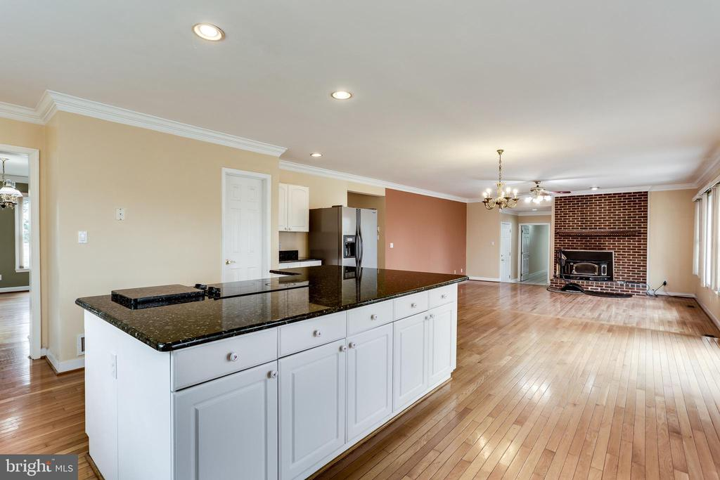 KITCHEN ISLAND  VIEW OF FAMILY ROOM WITH FIREPLACE - 7365 BEECHWOOD DR, SPRINGFIELD